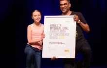 Greta Thunberg accepts the Amnesty International Ambassodor of Conscience Award from Kumi Naidoo at the Lisner Auditorium on Monday, September 16th, 2019